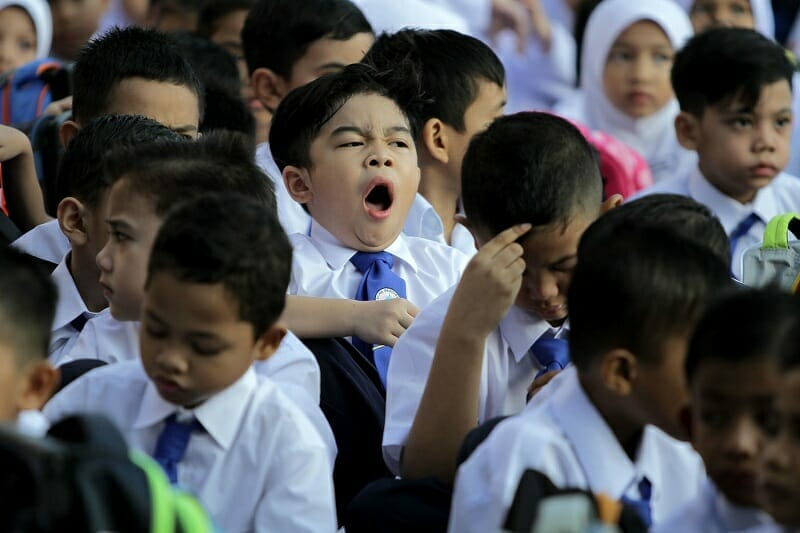 schoolkid yawning during morning assembly