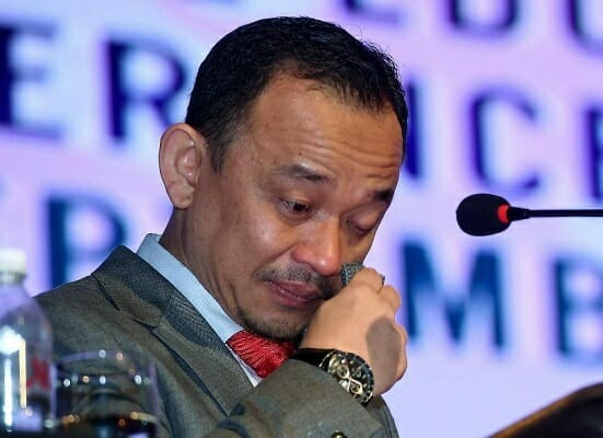Education minister Maszlee wiping away tears