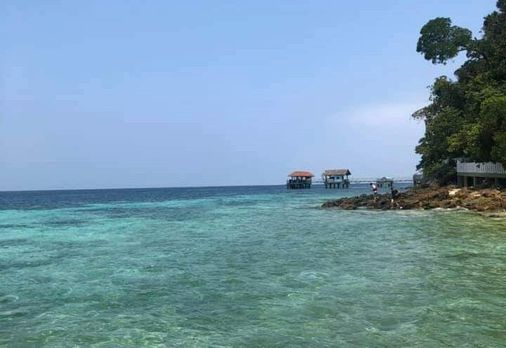 The sea at Pulau Tioman, calm waters during a clear, sunny day.