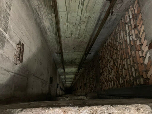 The elevator shaft, with no elevator or elevator cables visible.