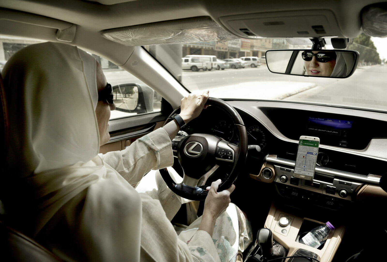 In this Sunday, June 24, 2018 photo, Ammal Farahat, who has signed up to be a driver for Careem, a regional ride-hailing service that is a competitor to Uber, drives her car in Riyadh, Saudi Arabia. After lifting a longstanding ban on women driving, it's the latest job opening for Saudi women, that had been reserved for men only, and one that sharply challenges traditional norms. (AP Photo/Nariman El-Mofty)