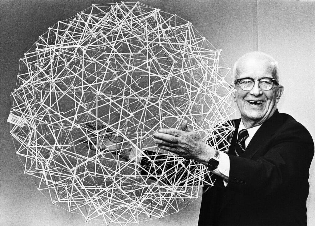 Buckminster Fuller with his patented molecule, the buckminsterfullerene.