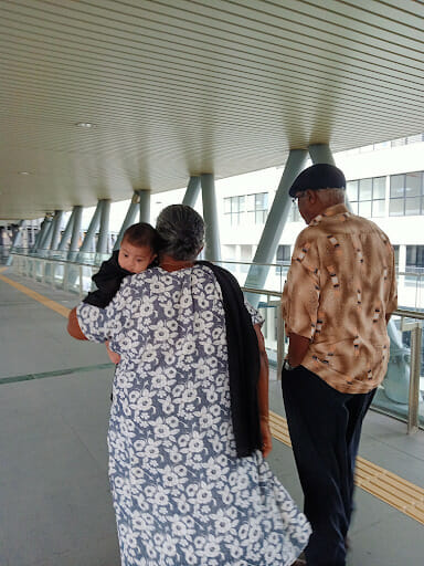 Arya draped in my grandma's shawl while walking them to the MRT.