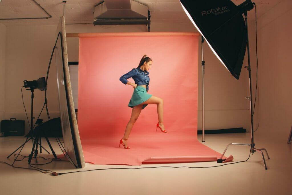 female model in a modelling studio taking a huge step forward